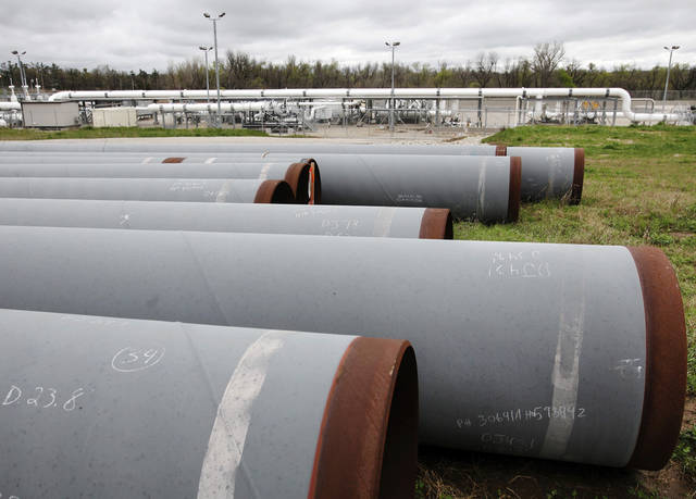 Large pipes ( 36 inches in diameter ) for carrying crude oil have been unloaded in a field near the TransCanada Corp. pipeline terminal on the south edge of Cushing. Residents and businesses of Cushing are preparing for the arrival of President Barack Obama this week. The president will make a brief stop at a TransCanada Corp. pipe yard northwest of town, as part of a four-state tour to promote the administration's energy  policy.    Photo by Jim Beckel, The Oklahoman