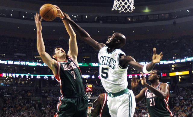 Boston Celtics forward Kevin Garnett, right, battles for a rebound against Milwaukee Bucks forward Ersan Ilyasova, of Turkey, in the first quarter of an NBA basketball game in Boston, Friday, Nov. 2, 2012. (AP Photo/Charles Krupa)