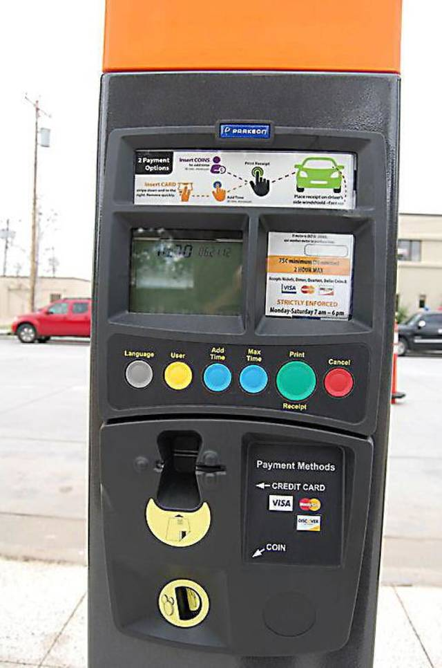 Orange-capped  meters  will indicate the spots may be reserved for up to two hours while blue-capped meters will be for only one hour. The new parking system goes live next month. Photo Provided