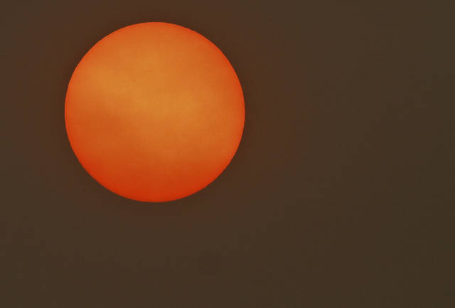 Thick clouds mask the sun early in the morning on Thursday, May 24, 2012, in Yukon, Oklahoma. Photo by Chris Landsberger, The Oklahoman