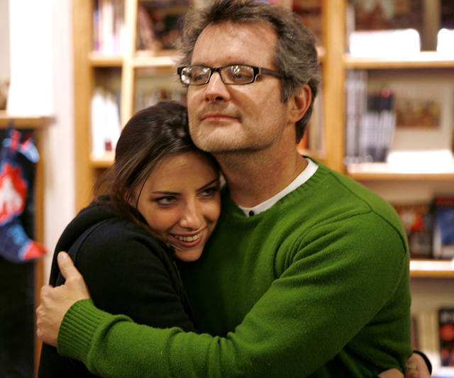 Jim hugs his daughter Maddye during his birthday party at Full Circle Books in Oklahoma City on Dec. 10, 2008. By John Clanton, The Oklahoman