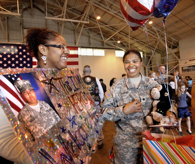 When 84 Oklahoma  Army National Guard troops marched into the hangar at the Air National Guard base in southwest Oklahoma City Saturday morning,  April 7, 2012, about 350 people, mostly family and friends, gave them a rousing and enthusiastic welcome. Their homecoming celebration marked the final return of soldiers with the 45th who had been deployed to Iraq and Afghanistan. Photo by Jim Beckel, The Oklahoman