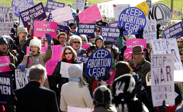 Abortion rights advocates shout during a rally in Capitol Square in Richmond, Va., Tuesday, Jan. 22, 2013, marking the 40th anniversary Tuesday of the landmark U.S. Supreme Court ruling on abortion known as Roe v. Wade. (AP Photo/Richmond Times-Dispatch, Bob Brown)