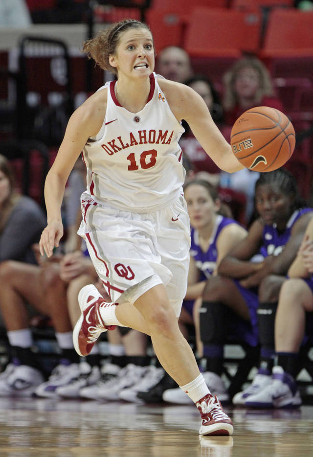 Oklahoma Sooners&#039; Morgan Hook (10) brings the ball down court in the second half as the University of Oklahoma (OU) Sooners defeated the Texas Christian University (TCU) Horned Frogs 82-54 in women&#039;s college basketball at the Lloyd Noble Center on Wednesday, Dec. 28, 2011, in Norman, Okla.  