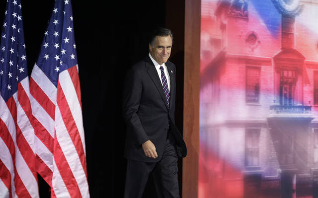 Republican presidential candidate and former Massachusetts Gov. Mitt Romney arrives to address supporters during his election night rally, Wednesday, Nov. 7, 2012, in Boston. President Obama defeated Republican challenger former Massachusetts Gov. Mitt Romney. (AP Photo/Elise Amendola)