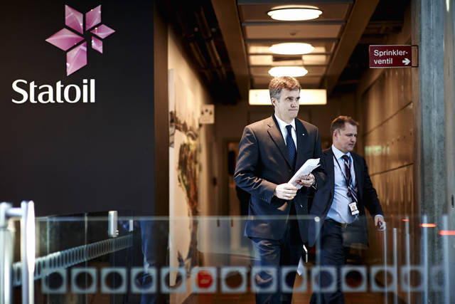 Statoil CEO Helge Lund, left, and Director of Foreign Operations, Lars Christian Bacher, exit from a meeting at Statoil head quarters building in Stavanger, Norway, Thursday Jan, 17, 2013.  Algerian forces raided the remote Amenas gas plant on Thursday in an attempt to free dozens of foreign hostages held by militants with ties to Mali's rebel Islamists, according to diplomats on Thursday, and Islamic militants claim that 35 hostages and 15 militants were killed after Algerian military helicopters strafed the area but said seven hostages survived.  (AP Photo / Kent Skibstad, NTB scanpix) NORWAY OUT