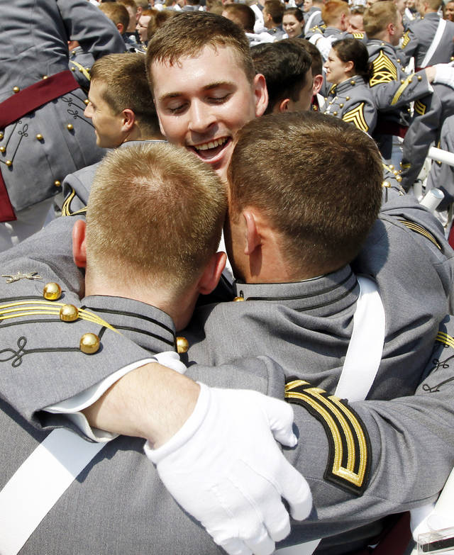 Cadets react after a graduation and commissioning ceremony at the U.S. Military Academy in West Point, N.Y., on Saturday, May 26, 2012. (AP Photo/Mike Groll)