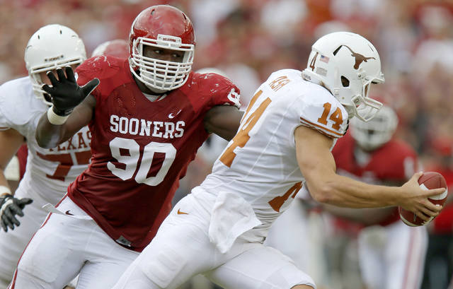 Oklahoma defensive end David King, left, chases Texas quarterback David Ash during the Sooners' 63-21 win on Oct. 13. PHOTO BY BRYAN TERRY, THE OKLAHOMAN