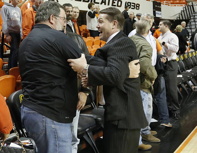 Travis Ford celebrates with fans after the 78-76 win over Iowa State during the college basketball game between the Oklahoma State University Cowboys (OSU) and the Iowa State University Cyclones (ISU) at Gallagher-Iba Arena on Wednesday, Jan. 30, 2013, in Stillwater, Okla.  Photo by Chris Landsberger, The Oklahoman