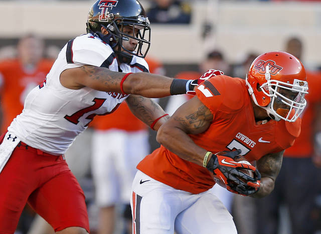 Oklahoma State&#039;s Shamiel Gary (7) runs past Texas Tech&#039;s Darrin Moore (14) after intercepting a pass during a college football game between Oklahoma State University (OSU) and Texas Tech University (TTU) at Boone Pickens Stadium in Stillwater, Okla., Saturday, Nov. 17, 2012.  Photo by Bryan Terry, The Oklahoman