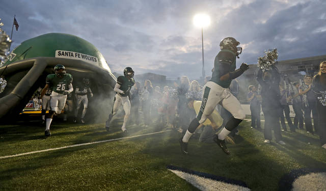 Edmond Santa Fe takes the field before their  their high school football game against Lawton at Wantland Stadium in Edmond, Okla., Thursday, October 11, 2012. Photo by Bryan Terry, The Oklahoman