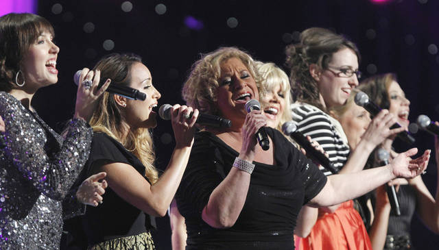 Oklahoma singer Sandi Patty, center, performs April 20 at the 42nd annual Dove Awards in Atlanta. The Dove Awards will return to Atlanta in 2012. AP photo