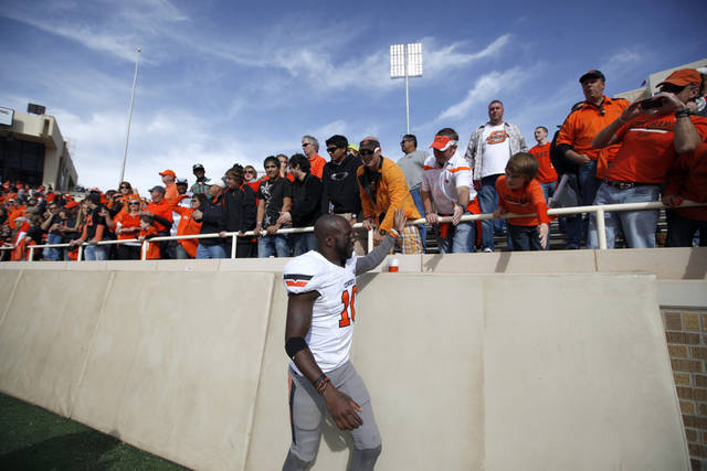 Oklahoma State's Markelle Martin (10) celebrates with fans during a college football game between Texas Tech University (TTU) and Oklahoma State University (OSU) at Jones AT&T Stadium in Lubbock, Texas, Saturday, Nov. 12, 2011.  Photo by Sarah Phipps, The Oklahoman  ORG XMIT: KOD