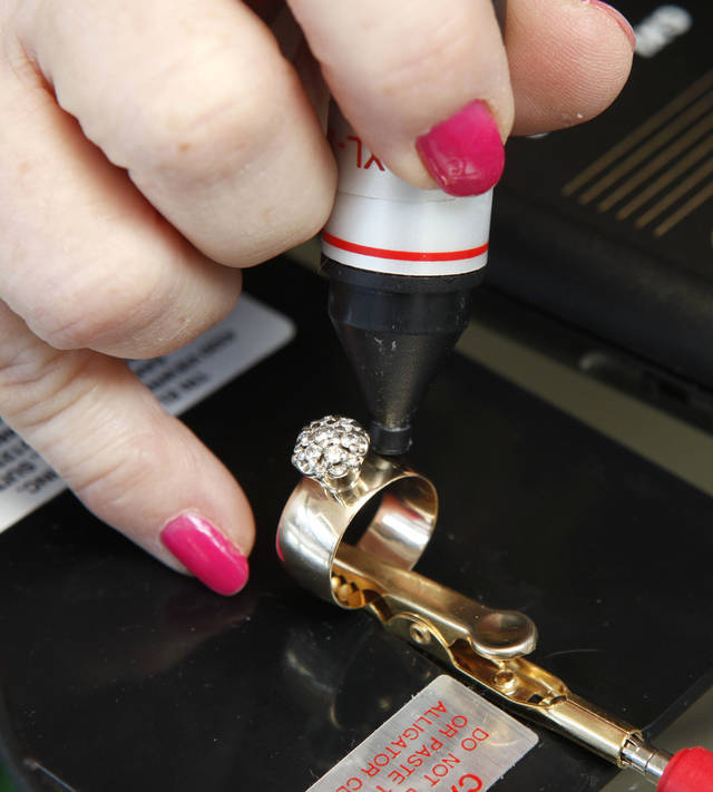 Gold and silver buyer Sandra Ward tests the gold content of a ring at the Silver and Gold Exchange at 1715 N. Portland in Oklahoma City, OK, Tuesday, January 8, 2013,  By Paul Hellstern, The Oklahoman