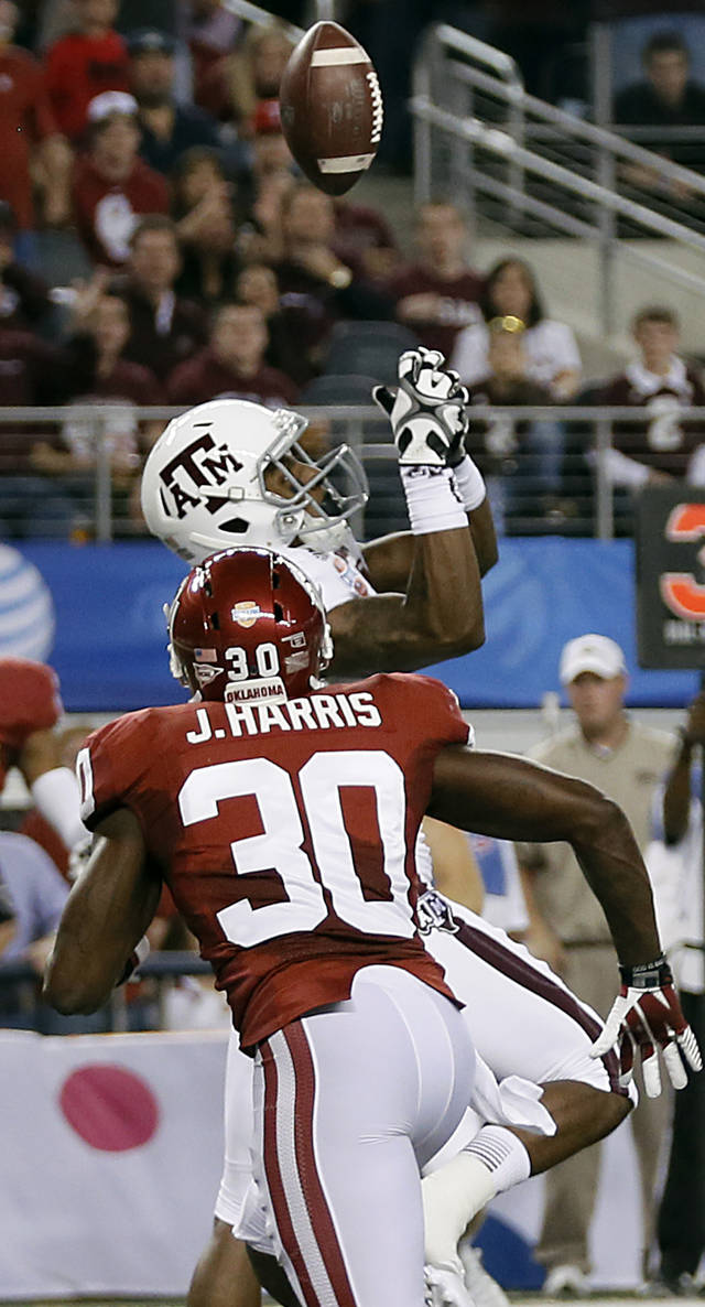 Texas A&M's Malcome Kennedy (84) tips up a pass that was intercepted by Oklahoma's Javon Harris (30) during the college football Cotton Bowl game between the University of Oklahoma Sooners (OU) and Texas A&M University Aggies (TXAM) at Cowboy's Stadium on Friday Jan. 4, 2013, in Arlington, Tx. Photo by Chris Landsberger, The Oklahoman