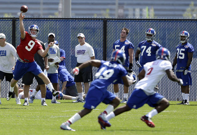 New York Giants quarterback Ryan Nassib (9), a fourth-round draft pick out of Syracuse, throws a pass during NFL football rookie minicamp, Friday, May 10, 2013, in East Rutherford, N.J. (AP Photo/Julio Cortez)