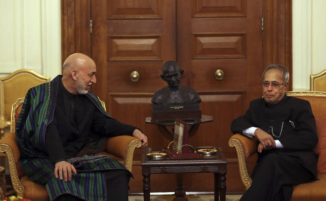 Indian President Pranab Mukherjee, right, listens to Afghan President Hamid Karzai during a meeting at the Indian Presidential Palace in New Delhi, India, Tuesday, May 21, 2013. Karzai is meeting with Indian leaders and is expected to seek increased military aid from India. India has invested more than $2 billion in Afghan infrastructure, including highways and hospitals and rural electricity projects. India is helping the Afghan government rebuild its police forces, judiciary and diplomatic services. (AP Photo/Manish Swarup)