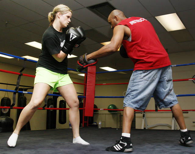 WOMAN / FEMALE: Boxer Kelly Trance, left, trains with coach Rodney Porter at American Top Team  in Oklahoma City, Thursday, June 7, 2012. Trance has slowed her career as a DJ to focus on being a professional boxer. Photo by Nate Billings, The Oklahoman