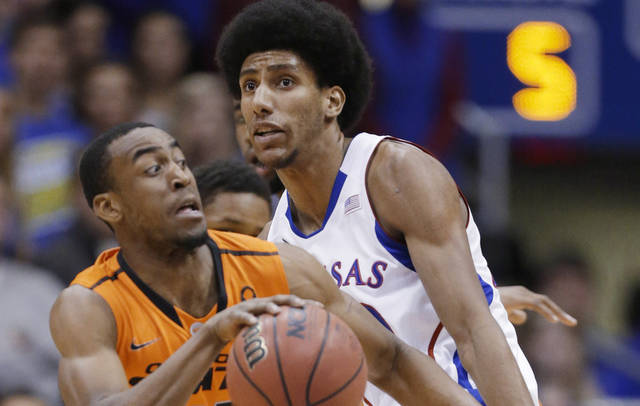 Oklahoma State guard Markel Brown (22) is fouled by Kansas forward Kevin Young (40) during the first half of an NCAA college basketball game in Lawrence, Kan., Saturday, Feb. 2, 2013. (AP Photo/Orlin Wagner) ORG XMIT: KSOW102