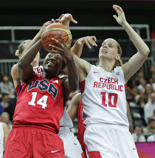 USA's Tina Charles grabs a rebound against Czech Republic's Alena Hanusova during a women's basketball game at the 2012 Summer Olympics, Friday, Aug. 3, 2012, in London. (AP Photo/Charles Krupa)