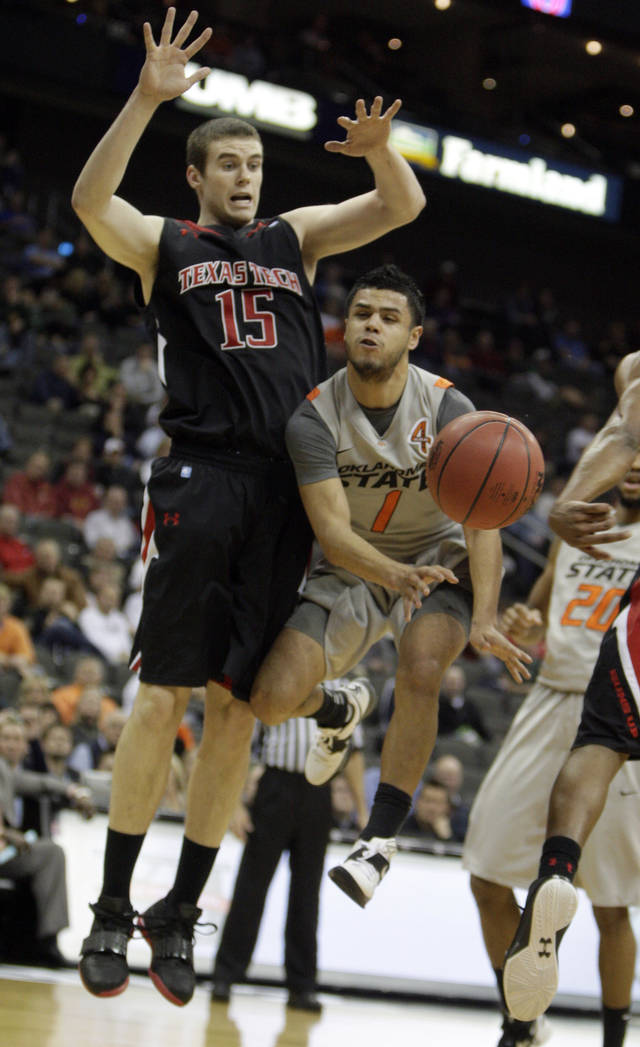 Oklahoma State's Cezar Guerrero (1) passes the ball as Texas Tech's Robert Lewandowski (15) defends during the Big 12 tournament men's basketball game between the Oklahoma State Cowboys and the Texas Tech Red Raiders at the Sprint Center, Wednesday, March, 6, 2012. Photo by Sarah Phipps, The Oklahoman