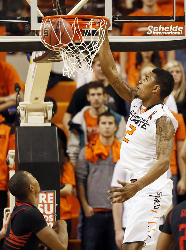 Oklahoma State's Le'Bryan Nash (2) dunks the ball during a men's college basketball game between Oklahoma State University (OSU) and Texas Tech at Gallagher-Iba Arena in Stillwater, Okla., Saturday, Jan. 19, 2013.  Photo by Nate Billings, The Oklahoman