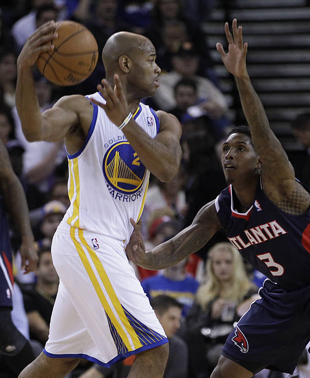 Golden State Warriors' Jarrett Jack, left, looks to pass from Atlanta Hawks' Louis Williams during the first half of an NBA basketball game Wednesday, Nov. 14, 2012, in Oakland, Calif. (AP Photo/Ben Margot)