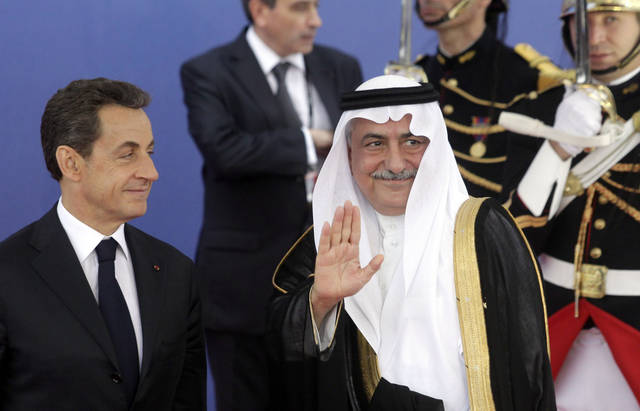 Saudi Arabia's Finance Minister Ibrahim Alassaf, right, speaks with French President Nicolas Sarkozy during arrivals for a G20 summit in Cannes, France on Thursday, Nov. 3, 2011. French President Nicolas Sarkozy will welcome Barack Obama of the U.S., Hu Jintao of China as well as the leaders of India, Brazil, Russia and the other members of the Group of 20 leading world economies in the city made famous by its annual film festival, but the event is far from the star turn the unpopular French leader had hoped to make six months before he faces a tough re-election vote. (AP Photo/Markus Schreiber)