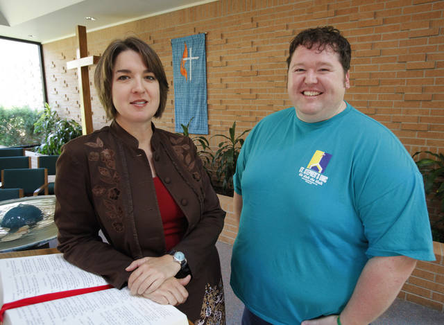 The Rev. Amy Venable, senior pastor of St. Stephen's United Methodist Church, and church member Jason Martin stand in the Norman church's sanctuary at 1801 W Brooks. Photo by Steve Sisney, The Oklahoman