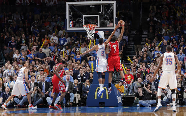 Oklahoma City 's Thabo Sefolosha (2) and Houston's Marcus Morris (2) battle under the basket during the NBA basketball game between the Houston Rockets and the Oklahoma City Thunder at the Chesapeake Energy Arena on Wednesday, Nov. 28, 2012, in Oklahoma City, Okla.   Photo by Chris Landsberger, The Oklahoman