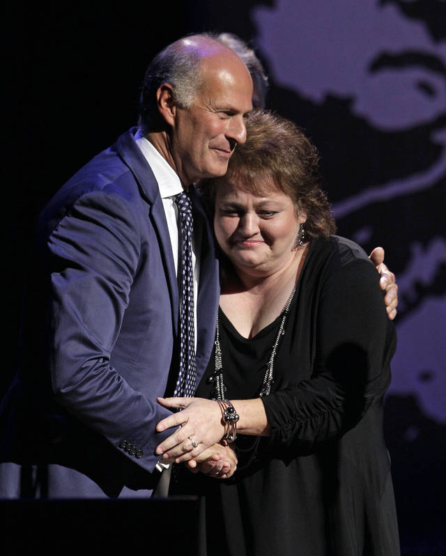 Dale Ann Bradley, right, gets a hug from Martino Coppo of the Italian bluegrass band Red Wine, as Bradley accepts the female vocalist of the year award at the International Bluegrass Music Association Awards show on Thursday, Sept. 29, 2011, in Nashville, Tenn. (AP Photo/Mark Humphrey)