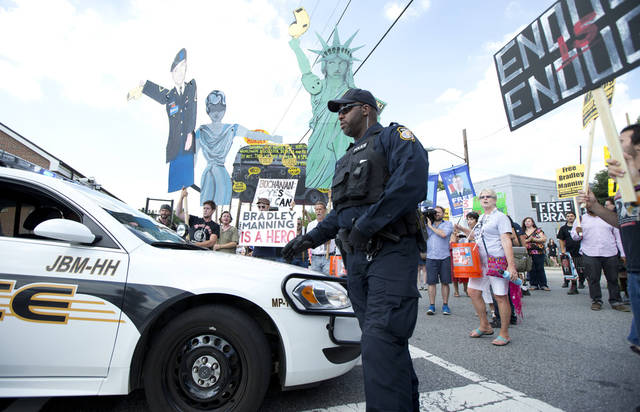 Supporters of Army Pfc. Bradley Manning are prevented by post police from entering Fort Lesley J. McNair on Friday in Washington, D.C., as protesters block the gate. AP Photo