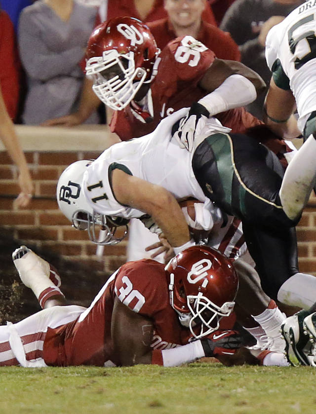 Baylor's Nick Florence (11) gets by Oklahoma's Javon Harris (30) and Chuka Ndulue (98) for a two point conversion during the college football game between the University of Oklahoma Sooners (OU) and Baylor University Bears (BU) at Gaylord Family - Oklahoma Memorial Stadium on Saturday, Nov. 10, 2012, in Norman, Okla.  Photo by Chris Landsberger, The Oklahoman
