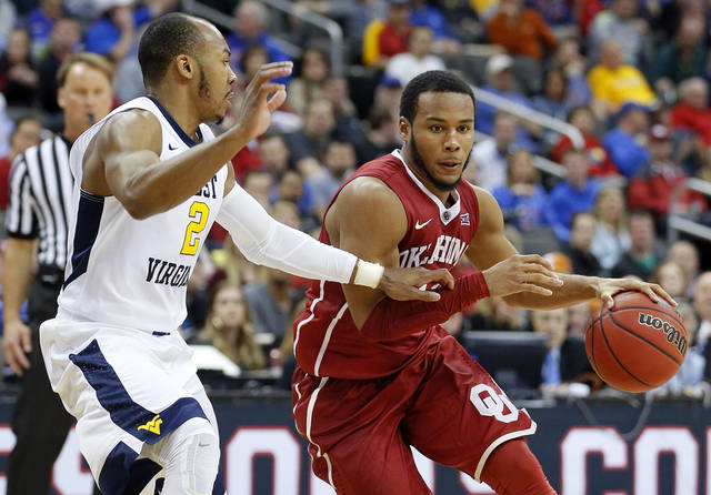 Sooners steal one in Morgantown, 89-87 in OT