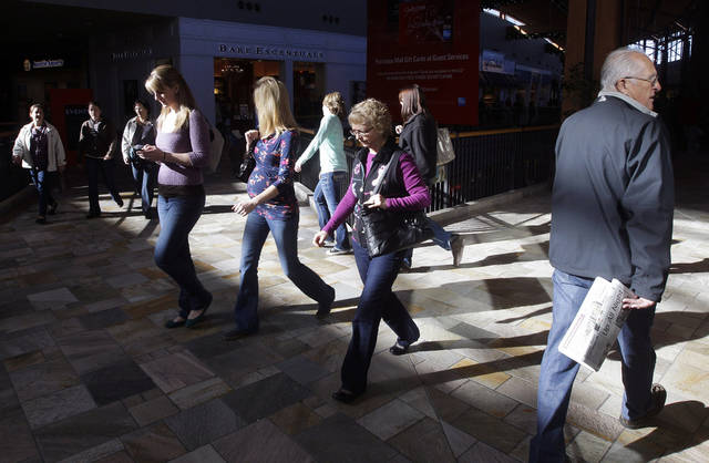 Shoppers explore the Flatirons Crossing Mall, in Broomfield, Colo., Friday Nov. 23, 2012. Black Friday, the day when retailers traditionally turn a profit for the year, got a jump start this year as many stores opened just as families were finishing up Thanksgiving dinner. (AP Photo/Brennan Linsley)