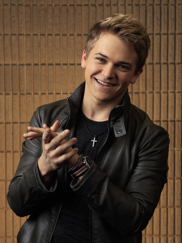 This March 8, 2012 photo shows Hunter Hayes in Nashville, Tenn. Hayes is one of several male performers included in the fan-voted top new artist category at the Academy of Country Music Awards. (AP Photo/Mark Humphrey)