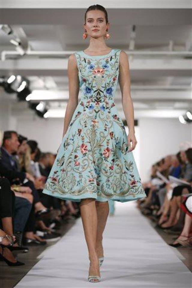 The Oscar de la Renta Spring 2014 collection is modeled during Fashion Week in New York, Tuesday, Sept. 10, 2013. (AP Photo/John Minchillo)