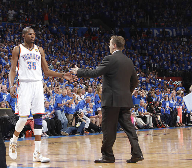 Oklahoma City's Kevin Durant (35) and coach Scott Brooks slap hand on the court during a timeout during Game 1 of the NBA Finals between the Oklahoma City Thunder and the Miami Heat at Chesapeake Energy Arena in Oklahoma City, Tuesday, June 12, 2012. Photo by Chris Landsberger, The Oklahoman