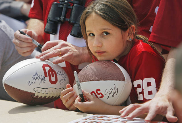 Jocie Rea McCuen, 9, from Wichita, Kansas, hopes for autographs before the University of Oklahoma Sooner's (OU) Spring Football game at Gaylord Family-Oklahoma Memorial Stadium on Saturday, April 16, 2011, in Norman, Okla.  