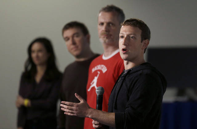 Facebook CEO Mark Zuckerberg, right, speaks with Director of Product Management Tom Stocky, second from left, and Director of Engineering Lars Rasmussen at Facebook headquarters  in Menlo Park, Calif., Tuesday, Jan. 15, 2013. Zuckerberg introduced &acirc;graph search&quot; Tuesday, a new service that lets users search their social connections for information about their friends&acirc; interests, and for photos and places.  (AP Photo/Jeff Chiu)
