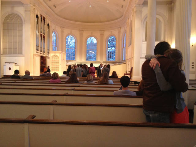 In this photo taken Sunday, Feb. 3, 2013, mourners embrace as others gathered at Kalamazoo College's Stetson Chapel in Kalamazoo, Mich., to remember Emily Stillman, 19, a sophomore who died that morning due to complications from bacterial meningitis. (AP Photo/Kalamazoo Gazette-MLive Media Group, Emily Monacelli) ALL LOCAL TV OUT; LOCAL TV INTERNET OUT
