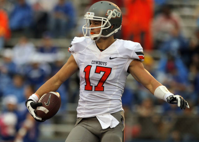 Oklahoma State's Charlie Moore (17) celebrates a touchdown during the college football game between Oklahoma State University (OSU) and the University of Kansas (KU) at Memorial Stadium in Lawrence, Kan., Saturday, Oct. 13, 2012. Photo by Sarah Phipps, The Oklahoman