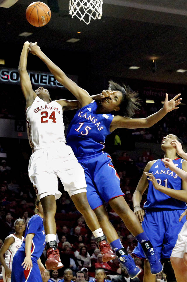 Kansas Jayhawks' Chelsea Gardner (15) tries to block a shot by Oklahoma Sooner's Sharane Campbell (24) as the University of Oklahoma Sooners (OU) play the Kansas Jayhawks in NCAA, women's college basketball at The Lloyd Noble Center on Saturday, March 2, 2013  in Norman, Okla. Photo by Steve Sisney, The Oklahoman