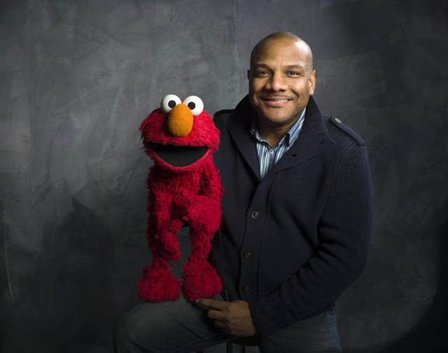 "FILE - In this Jan. 24, 2011 file photo, Elmo puppeteer Kevin Clash poses with the ""Sesame Street"" muppet in the Fender Music Lodge during the 2011 Sundance Film Festival in Park City, Utah. The man who accused Clash of having sex with him when he was a teen now says it isn't so. The man said in a statement released on Tuesday, Nov. 13, 2012 that his sexual relationship with Clash was adult and consensual. (AP Photo/Victoria Will, File)"
