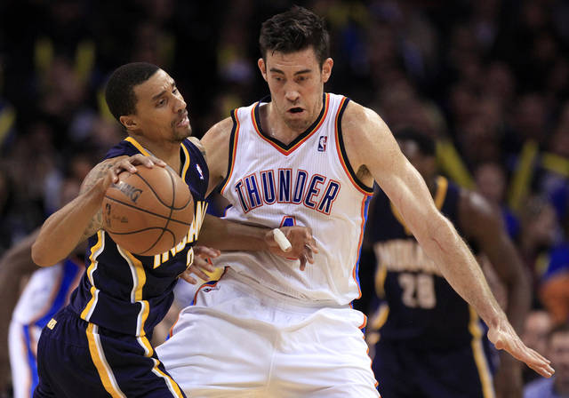 Oklahoma City's Nick Collison (4) is called for a foul while defending Indiana's George Hill (3) during the NBA game between the Indiana Pacers and the Oklahoma City Thunder at the Chesapeake Energy Arena   Sunday,Dec. 9, 2012. Photo by Sarah Phipps, The Oklahoman