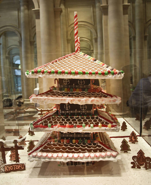"This Nov. 30, 2012 photo shows ""Toji Tower,"" a gingerbread creation from Kyotufo, on display in the lobby area of Le Parker Meridien hotel in New York.  The landmark-inspired creation is being exhibited with other over-the-top gingerbread houses from city restaurants in the annual display to benefit City Harvest, a food rescue organization for feeding the needy.  (AP Photo/Bebeto Matthews)"