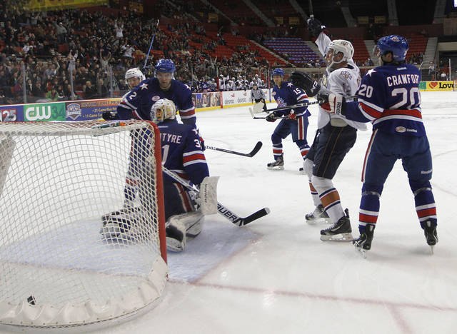 AHL HOCKEY / CELEBRATION: OKC's Josh Green (12) celebrates after scoring a goal during a game between the Oklahoma City Barons and the Rochester Americans at the Cox Convention Center in Oklahoma City, Tuesday, Dec. 27, 2011.  Photo by Garett Fisbeck, The Oklahoman  ORG XMIT: KOD