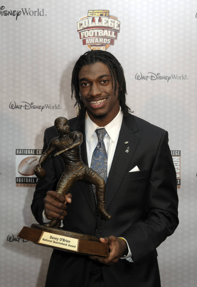 Baylor quarterback Robert Griffin III poses with the Davey O'Brien Award for the nation's top college quarterback, during the College Football Awards show in Lake Buena Vista, Fla., Thursday, Dec. 8, 2011 .(AP Photo/Phelan M. Ebenhack)