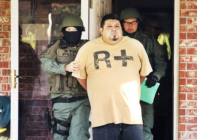 Oklahoma Bureau of Narcotics and Dangerous Drugs Control agents arrest Miguel Angel Aguirre on Monday at 617 SW 11 in Oklahoma City during a raid on individuals connected with a Mexican methamphetamine network in central Oklahoma.  Photos by  Paul B. Southerland,  The Oklahoman