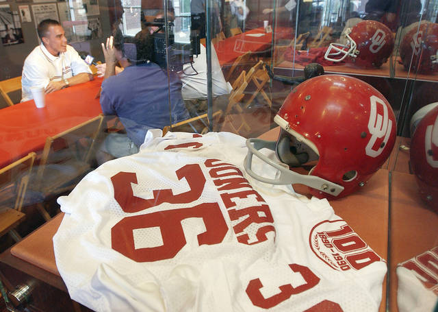 COLLEGE FOOTBALL: Defensive back Matt McCoy talks with the media at the Bob Stoops media luncheon at the Barry Switzer Center on the OU campus. In the foreground is Steve Owens jersey and helmet.  Staff Photo by David McDaniel.